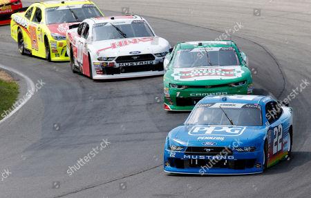 Austin Cindric (22) leads Elliott Sadler (1), Cole Custer (00) and Brandon Jones (19) at the start of the NASCAR Xfinity series auto race at Mid Ohio Sports Car Course in Lexington, OH