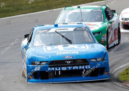 Austin Cindric (22) leads Elliott Sadler (1) through a corner during the NASCAR Xfinity series auto race at Mid Ohio Sports Car Course in Lexington, OH