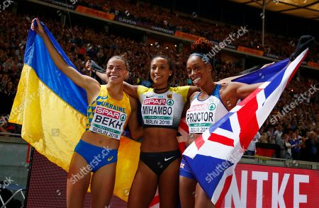 Germany's gold medal winner Malaika Mihambo is flanked by Ukraine's silver medal winner Maryna Bekh, left, and Britain's bronze medal winner Shara Proctor as they celebrate after the women's long jump final at the European Athletics Championships at the Olympic stadium in Berlin, Germany