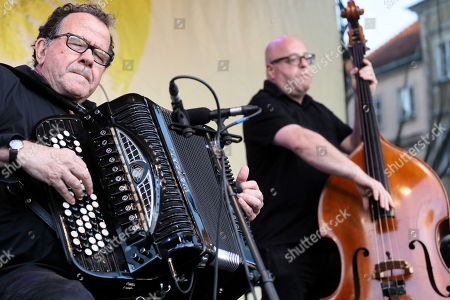 French multi-instrumentalist, accordion virtuoso, bandoneon and composer Richard Galliano (L) performs at the Old Town Market Square in Warsaw, Poland, 11 August 2018 as part of the ongoing International Open Jazz Festival in the Old Town.