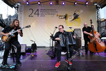 Stock Picture of French multi-instrumentalist, accordion virtuoso, bandoneon and composer Richard Galliano (C) performs at the Old Town Market Square in Warsaw, Poland, 11 August 2018 as part of the ongoing International Open Jazz Festival in the Old Town.