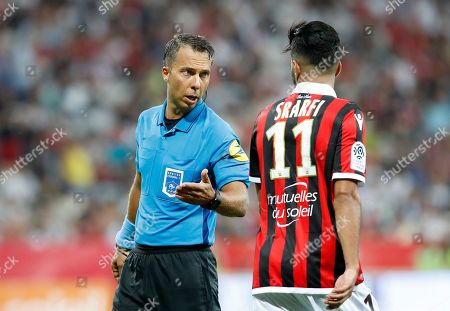 Stock Photo of French referee Johan Hamel speaks with Bassem Srarfi of OGC Nice during the French Ligue 1 soccer match between OGC Nice and Reims at the Allianz Riviera stadium, in Nice, France, 11 August 2018.