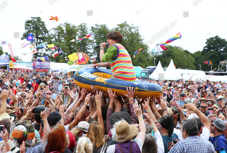 Stock Picture of 'The Bar-Steward Sons of Val Doonican' round off their set at Cropredy Festval with a bit of dinghy crowd-surfing