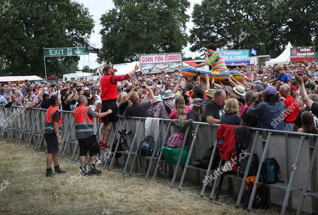 Stock Image of One of 'The Bar-Steward Sons of Val Doonican' gets welcomes back to the stage after a spot of dinghy crowd-surfing at Cropredy Festval