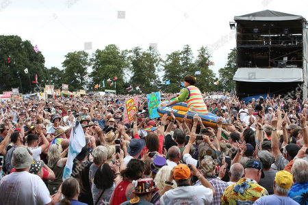 'The Bar-Steward Sons of Val Doonican' round off their set at Cropredy Festval with a bit of dinghy crowd-surfing