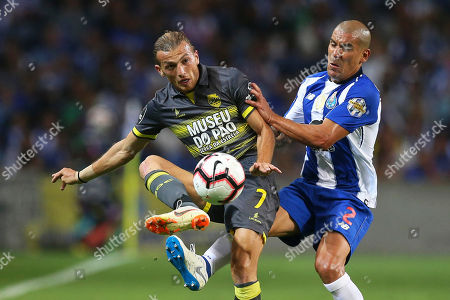 FC Porto's Maxi Pereira (R) in action against Chaves' Avtandil Ebralidze 'Avto' (L) during the Portuguese First League soccer match between FC Porto and GD Chaves at Dragao stadium in Porto, Portugal, 11 August 2018.