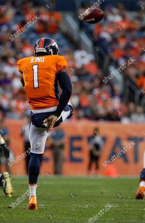 Denver Broncos punter Marquette King punts against the Minnesota Vikings during the first half in an NFL football preseason game, in Denver