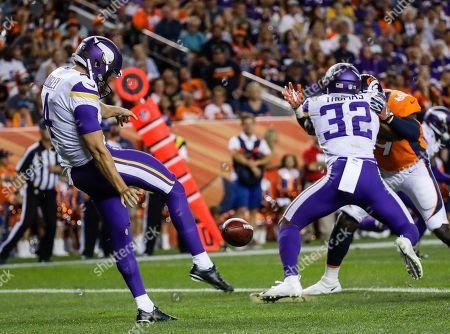 Minnesota Vikings punter Ryan Quigley punts against the Denver Broncos during the first half in an NFL football preseason game, in Denver