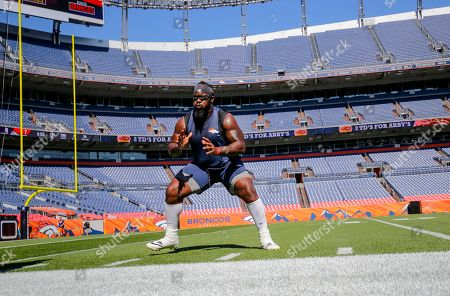 Menelik Watson. Denver Broncos wide receiver Mark Chapman runs a drill before the start of an NFL football game against the Minnesota Vikings, in Denver