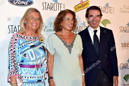 Spanish former Prime Minitre Jose Maria Aznar (R) and his wife, former Madrid's Mayor Ana Botella (C) pose as they arrive to the Starlite charity gala to raise funds for social projects held in Marbella, southern Spain, 11 August 2018.