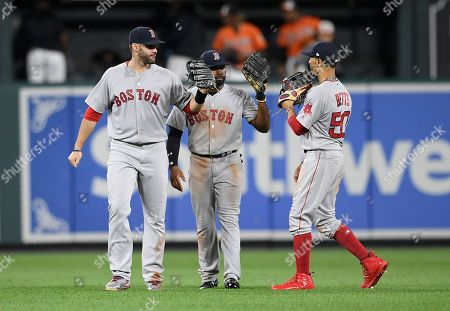 Boston Red Sox's J.D. Martinez, left, Jackie Bradley Jr., center, and Mookie Betts celebrate after the second baseball game of a split doubleheader, in Baltimore. The Red Sox defeated the Baltimore Orioles 6-4