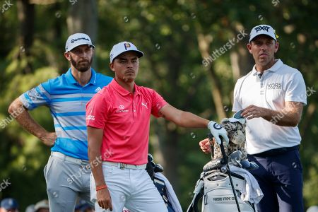 Rickie Fowler of the US, (C), Dustin Johnson of the US (L) and Charl Schwartzel of South Africa (R) on the 15th tee during round three of the 100th PGA Championship golf tournament at Bellerive Country Club in St. Louis, Missouri, USA, 11 August 2018.