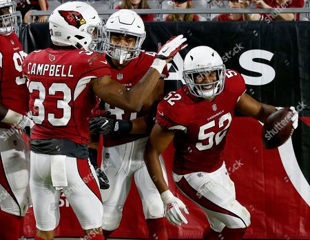 Arizona Cardinals linebacker Jeremy Cash (52) celebrates his fumble recovery for a touchdown against the Los Angeles Chargers with defensive back Chris Campbell (33) and defensive back Ezekiel Turner (47) during the second half of a preseason NFL football game, in Glendale, Ariz