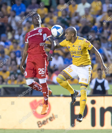 Tigres' Luis Rodriguez (R) vies for the ball with Diablos Rojos' Cristian Borja during a game of the Mexican Tournament, in Monterrey, Mexico, 11 August 2018.