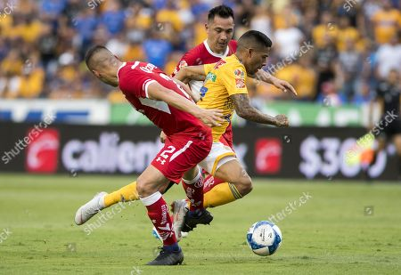 Tigres' Javier Aquino (R) vies for the ball with Diablos Rojos' Omar Tobio during a game of the Mexican Tournament, in Monterrey, Mexico, 11 August 2018.