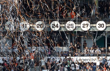 Confetti flies during a ceremony to retire the jersey number of former San Francisco Giants player Barry Bonds, 25, before a baseball game between the Giants and the Pittsburgh Pirates in San Francisco