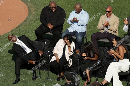 Former San Francisco Giants player Barry Bonds, from (Bottom-L) laughs at a joke told by former manager Dusty Baker next to his mother Pat and his children Aisha and Shikari at a ceremony to retire Bonds' jersey number before a baseball game between the Giants and the Pittsburgh Pirates in San Francisco,California, USA, 11 August 2018.