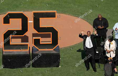 """Former San Francisco Giants player Barry Bonds acknowledges the crowd during his team jersey number '25' retirement ceremony at AT&T Park prior to the Giants MLB game against the Pittsburgh Pirates in San Francisco, California, USA, 11 August 2018. Bond's late father, Bobby, who played for the Giants also wore jersey """"25"""".  Bond's holds the MLB record for most home run in a single season with 73 home runs, and for career home runs at 762."""