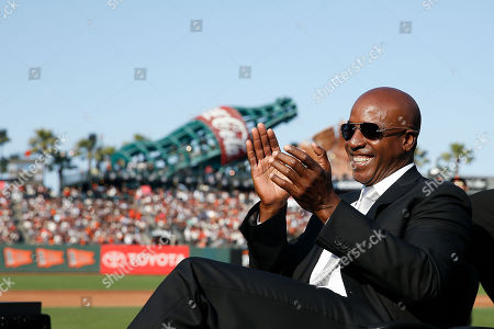 """Former San Francisco Giants player Barry Bonds looks on during a ceremony to retire his #25 jersey at AT&T Park in San Francisco, California, USA, 11 August 2018. Bond's late father, Bobby, who played for the Giants also wore jersey """"25"""".  Bond's holds the MLB record for most home run in a single season with 73 home runs, and for career home runs at 762."""