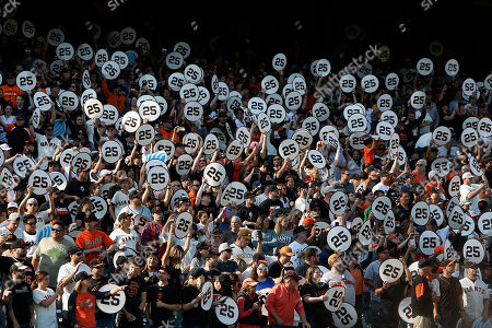 """Fans hold up Former San Francisco Giants player Barry Bonds number 25 during a ceremony to retire his #25 jersey at AT&T Park in San Francisco, California, USA, 11 August 2018. Bond's late father, Bobby, who played for the Giants also wore jersey """"25"""".  Bond's holds the MLB record for most home run in a single season with 73 home runs, and for career home runs at 762."""
