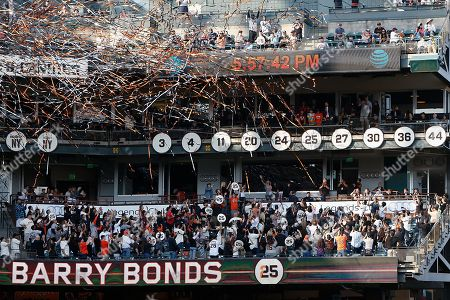 """Former San Francisco Giants player Barry Bonds number 25 is unveiled during a ceremony to retire his #25 jersey at AT&T Park in San Francisco, California, USA, 11 August 2018. Bond's late father, Bobby, who played for the Giants also wore jersey """"25"""".  Bond's holds the MLB record for most home run in a single season with 73 home runs, and for career home runs at 762."""