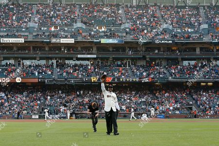 """Former San Francisco Giants player Barry Bonds acknowledges the crowd during a ceremony to retire his #25 jersey at AT&T Park in San Francisco, California, USA, 11 August 2018. Bond's late father, Bobby, who played for the Giants also wore jersey """"25"""".  Bond's holds the MLB record for most home run in a single season with 73 home runs, and for career home runs at 762."""