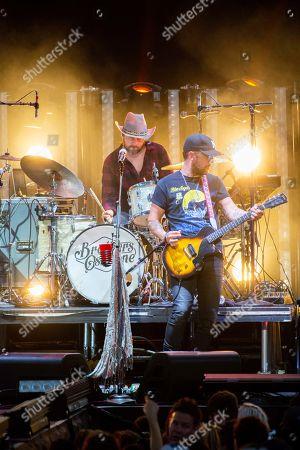 Stock Photo of T. J. Osborne, of The Brothers Osborne performs on stage at Verizon Wireless Amphitheatre, in Alpharetta, Ga
