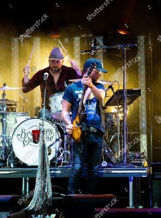 Stock Picture of T. J. Osborne, of The Brothers Osborne performs on stage at Verizon Wireless Amphitheatre, in Alpharetta, Ga
