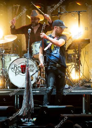 T. J. Osborne, of The Brothers Osborne performs on stage at Verizon Wireless Amphitheatre, in Alpharetta, Ga
