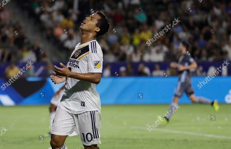 LA Galaxy forward Giovani dos Santos reacts to a missed shot during the first half of an MLS soccer match against the Minnesota United, in Carson, Calif