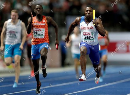 Britain's Harry Aikines-Aryeetey runs to win the men's 4 x 100 meter relay final race for Britain at the European Athletics Championships in Berlin, Germany