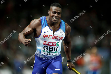 Britain's Harry Aikines-Aryeetey celebrates winning the men's 4 x 100 meter relay final race for Britain at the European Athletics Championships in Berlin, Germany