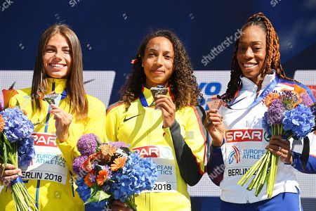 Malaika Mihambo (C) of Germany poses with her gold medal on the podium after winning the women's Long Jump final at the Athletics 2018 European Championships in Berlin, Germany, 12 August 2018. Mihambo won ahead of second placed Maryna Bekh (L) of Ukraine and third placed Shara Proctor (R) of Britain.