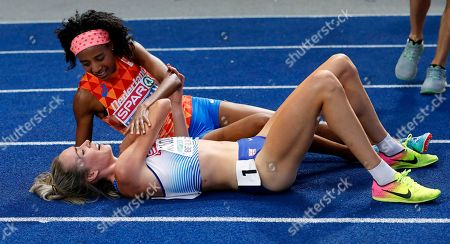 Sifan Hassan (back) of the Netherlands celebrates with second placed Eilish McColgan (front) of Britain after winning the women's 5,000m final at the Athletics 2018 European Championships, Berlin, Germany, 12 August 2018.