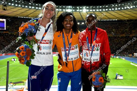 (L-R) Silver, Gold and Bronze medalists Britain's Eilish McColgan, The Netherland's Sifan Hassan and Turkey's Yasemin Can celebrate after the Women's 5000m final at the Athletics 2018 European Championships, Berlin, Germany, 12 August 2018.