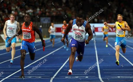 Harry Aikines-Aryeetey (C) of Britain crosses the finish line to win the men's 4x100m Relay final at the Athletics 2018 European Championships, Berlin, Germany, 12 August 2018. At left third placed Taymir Burnet of the Netherlands.