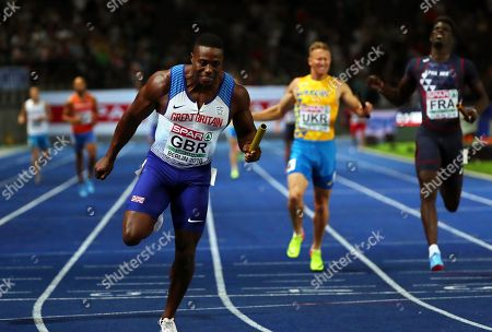 Harry Aikines-Aryeetey (L) of Britain crosses the finish line to win the men's 4x100m Relay final at the Athletics 2018 European Championships, Berlin, Germany, 12 August 2018.