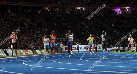 Harry Aikines-Aryeetey (C) of Britain is on his way to win the men's 4x100m Relay final at the Athletics 2018 European Championships, Berlin, Germany, 12 August 2018. At left second placed Ramil Guliyev of Turkey.