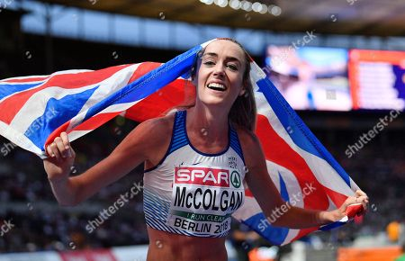 Britain's Eilish McColgan celebrates after winning the silver medal in the women's 5000-meter final at the European Athletics Championships in the Olympic stadium in Berlin, Germany