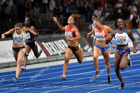 Britain's Dina Asher-Smith, right, crosses the line ahead of, from left, Germany's Rebekka Haase, Switzerland's Salome Kora and Netherlands' Naomi Sedney in the women's 4x100-meter final at the European Athletics Championships in the Olympic stadium in Berlin, Germany