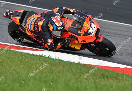 Britain's rider Bradley Smith of the Red Bull KTM Factory Racing rides during a warm up session for the MotoGP race at the Austrian motorcycle Grand Prix at the Red Bull Ring in Spielberg, Austria