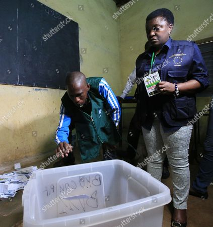 Stock Photo of The head of the EU observation mission, Cecile Kyenge (R), visits a polling station during ballot counting, after voting closed in the second round of the presidential election in Bamako, Mali, 12 August 2018.  The incumbent President Ibrahim Boubacar Keita is expected to beat the opposition challenger, Soumaila Cisse of the Republic and Democracy (URD), for a second five-year term.