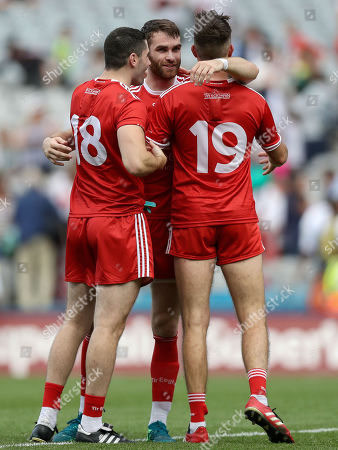 Monaghan vs Tyrone. Tyrone?s Ronan McNamee celebrates after the game with Michael Cassidy and Harry Loughran