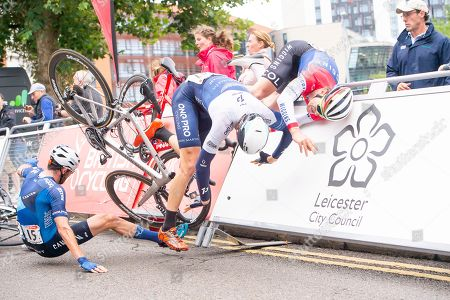 One Pro Cycling's Chris Latham slides into Team Wiggins' Robert Scott to cause a crash at the sprint finish of the Leicester Castle Classic as Canyon Eisberg's Andy Tennant gets caught up in it.