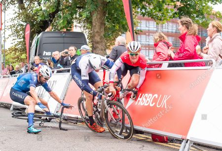 Stock Photo of One Pro Cycling's Chris Latham slides into Team Wiggins' Robert Scott to cause a crash at the sprint finish of the Leicester Castle Classic as Canyon Eisberg's Andy Tennant gets caught up in it.
