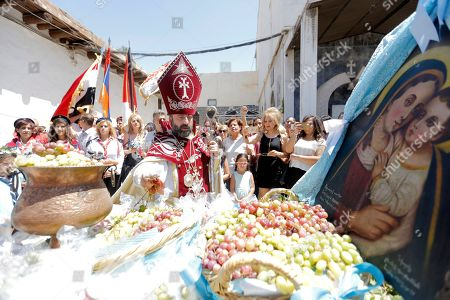 A Syrian-Armenian Orthodox priest leads the commemoration of Eid Al Saydeh, or Feast of the Assumption of the Virgin Mary, at the Orthodox Armenian Church in the old city of Damascus, Syria, 12 August 2018. The Feast of the Assumption of the Virgin Mary celebrates, according to the beliefs of the Christian churches, the bodily and spiritual ascension of Virgin Mary into Heaven at the end of her human life.
