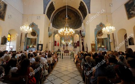 Syrian-Armenian Christian worshippers and clergymen pray as they commemorate the Eid Al Saydeh, or Feast of the Assumption of the Virgin Mary, at the Orthodox Armenian Church in the old city of Damascus, Syria, 12 August 2018. The Feast of the Assumption of the Virgin Mary celebrates, according to the beliefs of the Christian churches, the bodily and spiritual ascension of Virgin Mary into Heaven at the end of her human life. Armenian boy scouts marching band in the Christian quarter of Damascus.