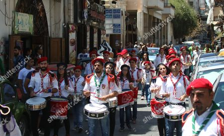 Members of a Syrian-Armenian Scout Band march to commemorate the Eid Al Saydeh, or Feast of the Assumption of the Virgin Mary, by the Orthodox Armenian Church in the old city of Damascus, Syria, 12 August 2018. The Feast of the Assumption of the Virgin Mary celebrates, according to the beliefs of the Christian churches, the bodily and spiritual ascension of Virgin Mary into Heaven at the end of her human life.