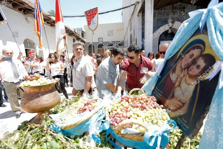 Syrian-Armenian Christians commemorate the Eid Al Saydeh, or Feast of the Assumption of the Virgin Mary, at the Orthodox Armenian Church in the old city of Damascus, Syria, 12 August 2018. The Feast of the Assumption of the Virgin Mary celebrates, according to the beliefs of the Christian churches, the bodily and spiritual ascension of Virgin Mary into Heaven at the end of her human life.
