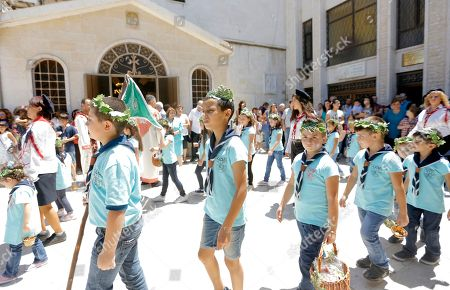 Syrian-Armenian boy scouts participate in celebrations of the Eid Al Saydeh, or Feast of the Assumption of the Virgin Mary, at the Orthodox Armenian Church in the old city of Damascus, Syria, 12 August 2018. The Feast of the Assumption of the Virgin Mary celebrates, according to the beliefs of the Christian churches, the bodily and spiritual ascension of Virgin Mary into Heaven at the end of her human life.